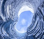 Blue skies above a blue ice cave in the South of Iceland in winter.