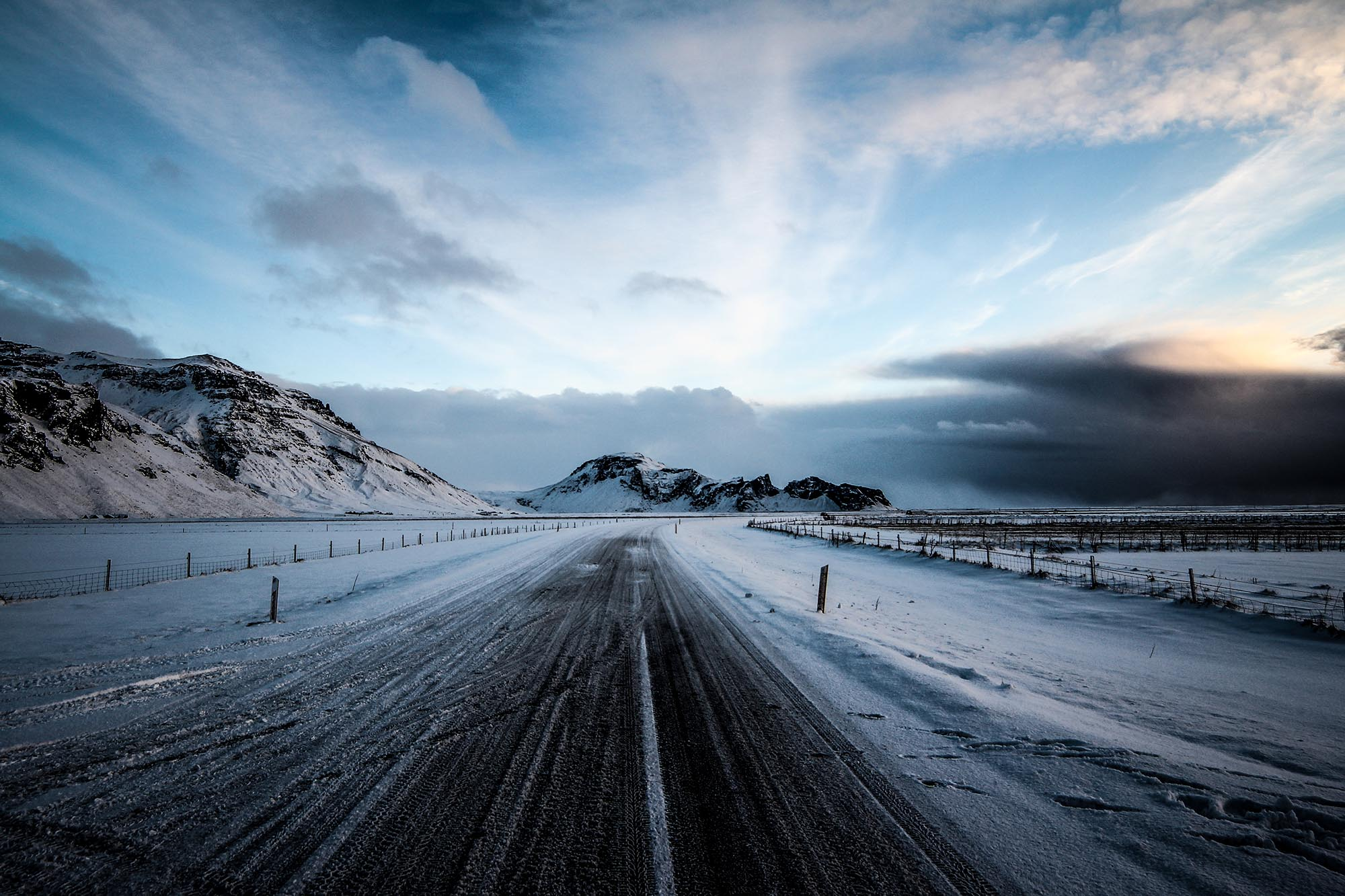 Driving along the ring road of Iceland guarantees spectacular mountain views on each side.