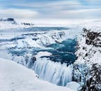 You'll see the beautiful Gullfoss waterfall blanketed in snow n on a winter super jeep tour of the Golden Circle.