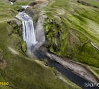 A view of the mighty Skógafoss waterfall from a helicopter.