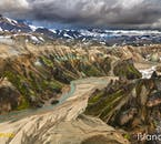 Witness the incredible mountains and valleys of the highlands in Iceland by helicopter.