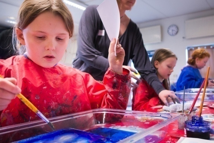 Children making crafts in the Reykjavik City Library, Iceland