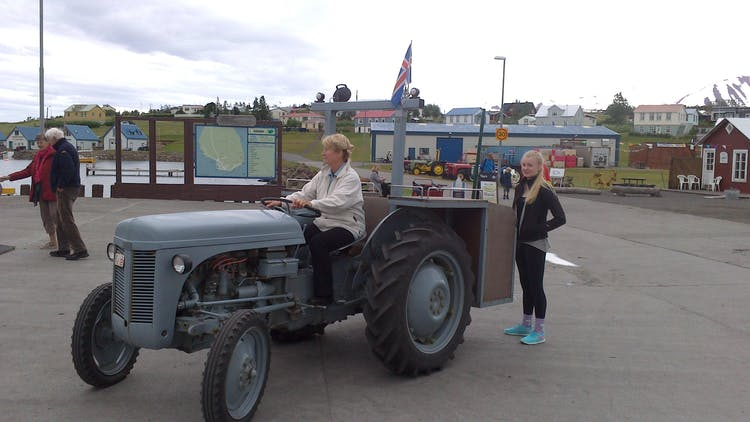 Take a tractor ride on Hrísey Island and get to know the friendly locals.