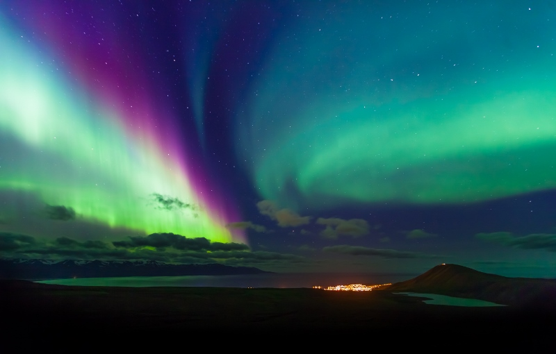 A range of colours dance over Húsavík in north Iceland, a great place to watch the Northern Lights.