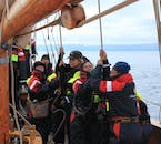 Try your luck at seamanship by boarding a wooden whale watching vessel in Iceland.