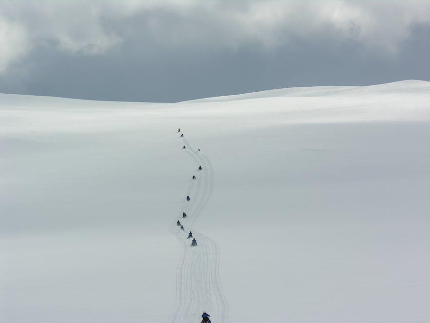 Snowmobiling across Langjokull glacier in Iceland