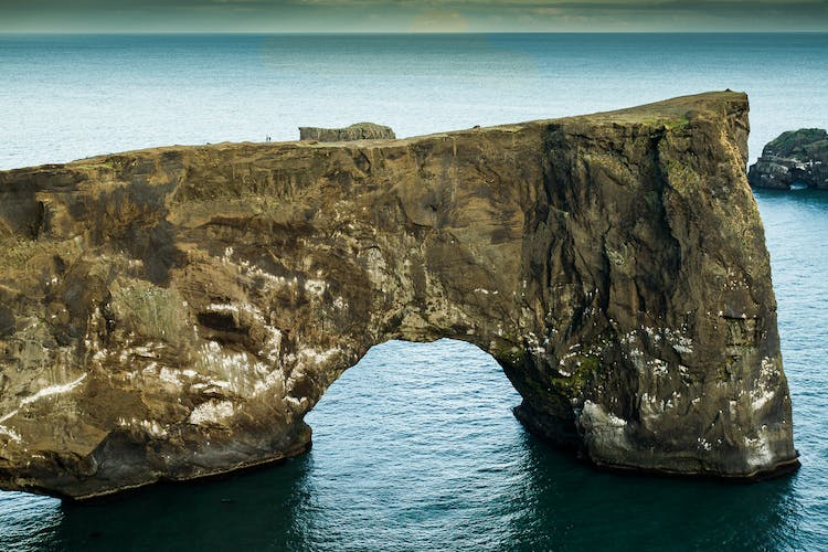 Dyrhólaey is instantly recognisable thanks to the distinctive rock arch that sits beneath the cliff face.