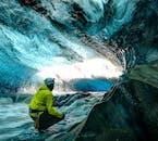 A stream runs through a Breiðamerkurjökull glacier cave in southeast Iceland.