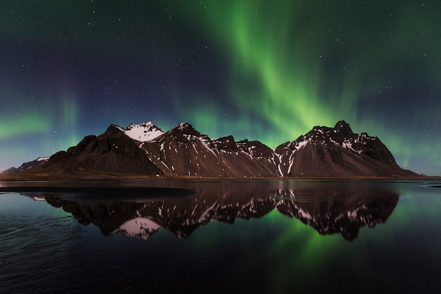 Vestrahorn mountain and Northern Lights in east Iceland