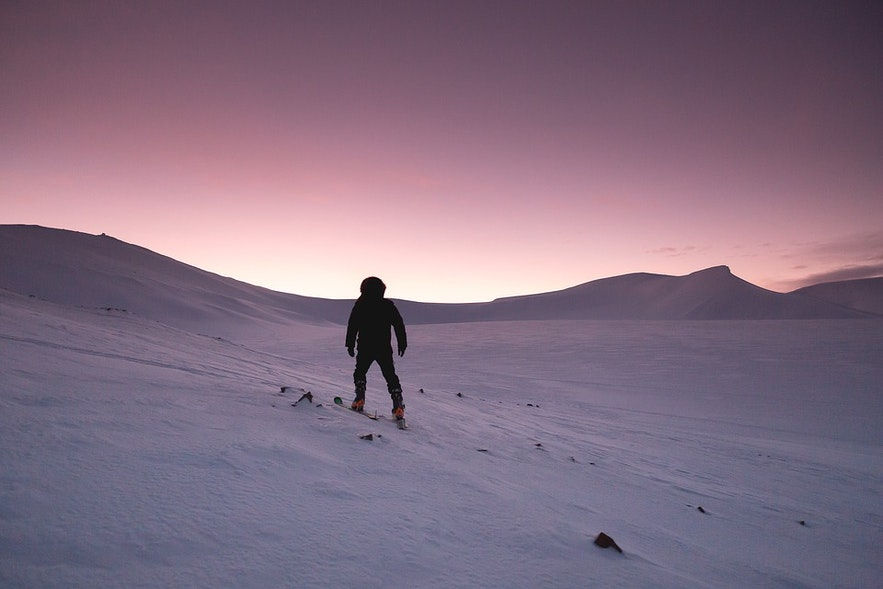 Skiing under the Northern Lights or dusk is a truly magical experience.