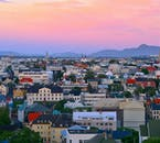 Iceland's capital Reykjavík is charming in its cluster-some appeal of multi-coloured houses, with Hallgrímskirkja Church towering in their midst.