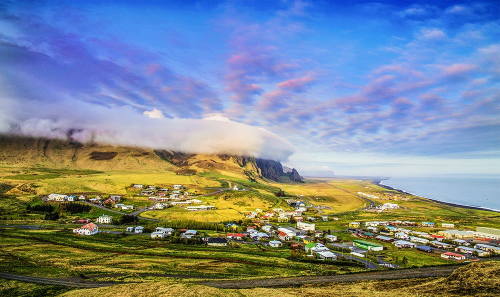 The beautiful village of Vík on the South Coast is surrounded by stunning nature.