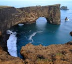 Dýrholaey rock arch as seen from the Dýrholaey cliffs in South Iceland.