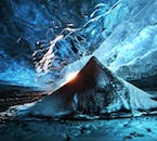Low winter sun reflecting on the ice walls of the Vatnajökull caves, hidden by snow blown in by the northern winds