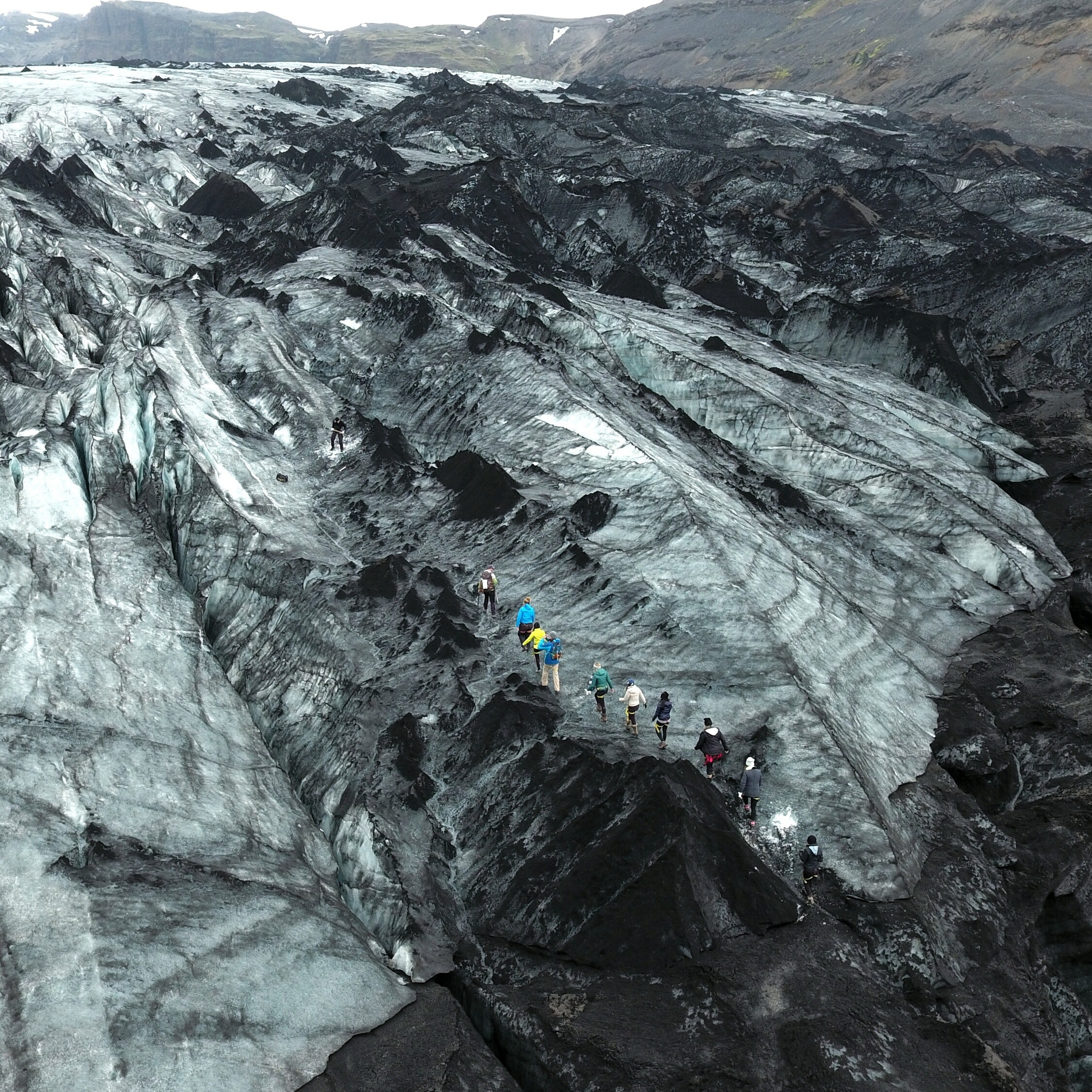 Sólheimajökull is renowned for its colouration, with powder white snow, black ash, and blue ice.