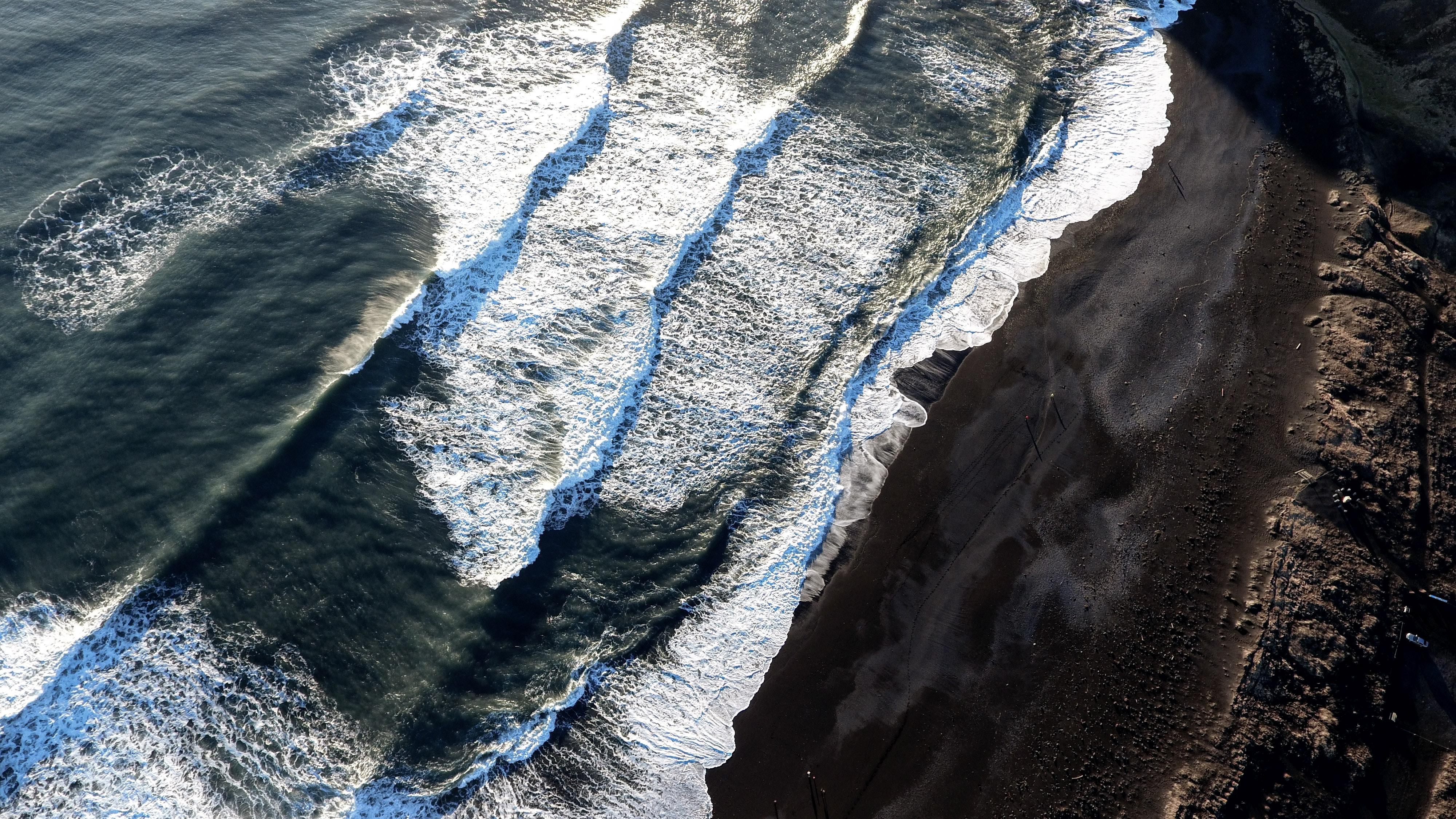 Aerial view of Reynisfjara's dangerous waves in January