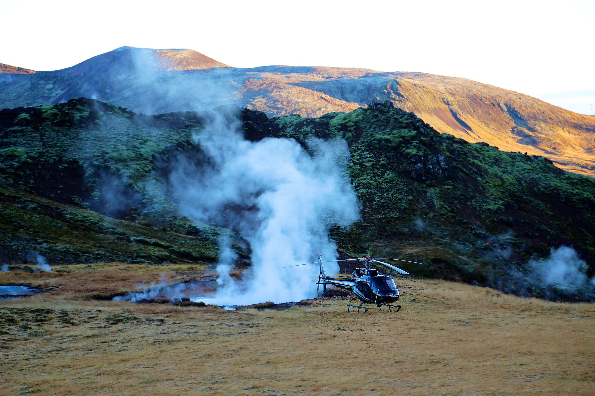 Helicopter touchdown on Hengill Volcano in southwest Iceland.
