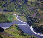 See Iceland's glacier rivers snake the ground below you on the Volcano Explorer Helicopter Tour.