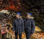 Guests marvelling at the beauty of Raufarhólshellir cave.