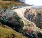 Geothermal activity under the surface has enlivened the colour palette of Reykjadalur Geothermal Valley.