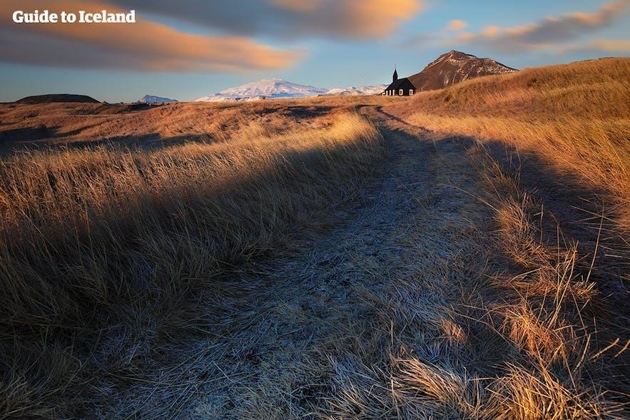 Snæfellsjökull glacier is the crown jewel of the Snæfellsnes Peninsula, seen here behind the black church at Búðir.