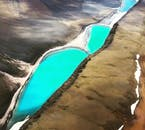 Vividly coloured lakes, seen from high above on a Flightseeing Tour Over the Golden Circle and Glymur Waterfall.