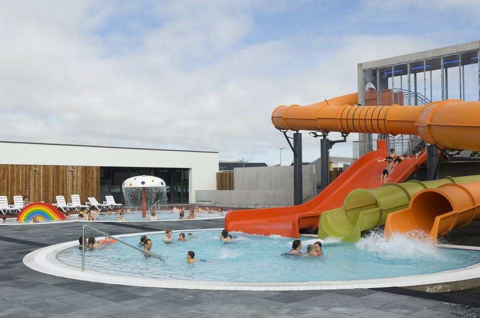 The best swimming pools in reykjavik relax in hot tubs for Nicest swimming pools