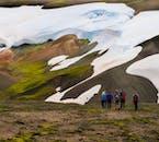 At Landmannalaugar, black ash meets white snow, green moss, and yellow mountains.