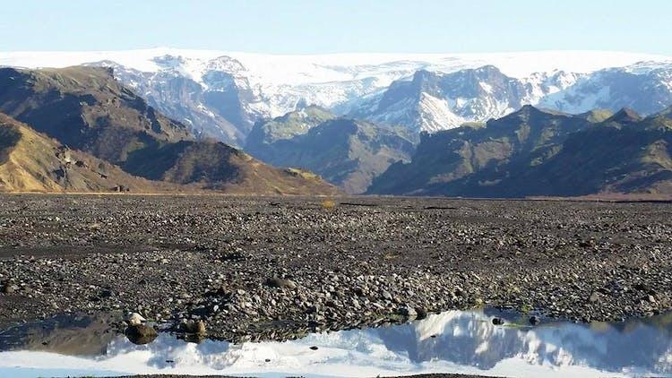 A view over lava in Vatnajökull National Park to the mighty Vatnajökull glacier.