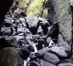 Exploring a canyon in the mountain ridge valley of Þórsmörk, one of Iceland's most popular hiking destinations.