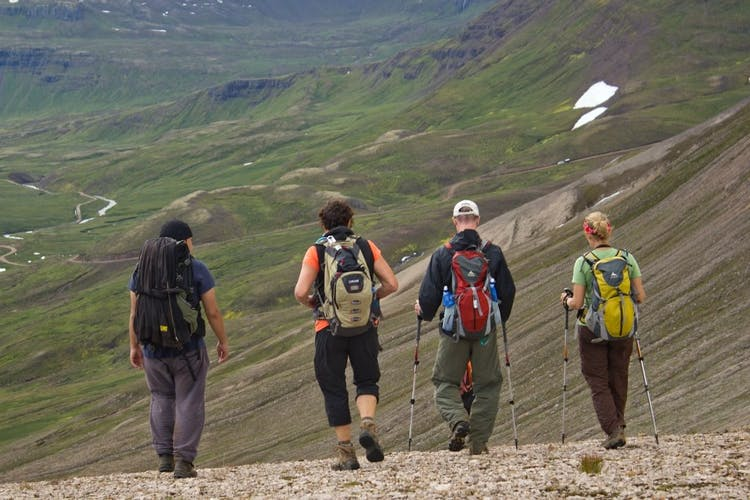 A group hiking over the mountains of the north and east fjords.