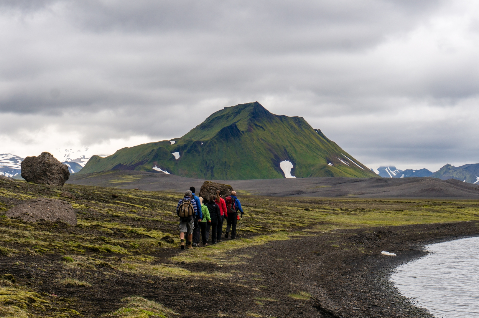 A hiking group in the highlands on the edge of Áltavatn, the Swan Lake.