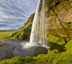 On a private super jeep tour of the South Coast, you'll see as the majestic Seljalandsfoss waterfall tumbles over a concave cliff face.