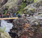 Follow roads paved by roaming sheep and small bridges built by farmers when traversing through the rugged terrain of the Icelandic Highlands.