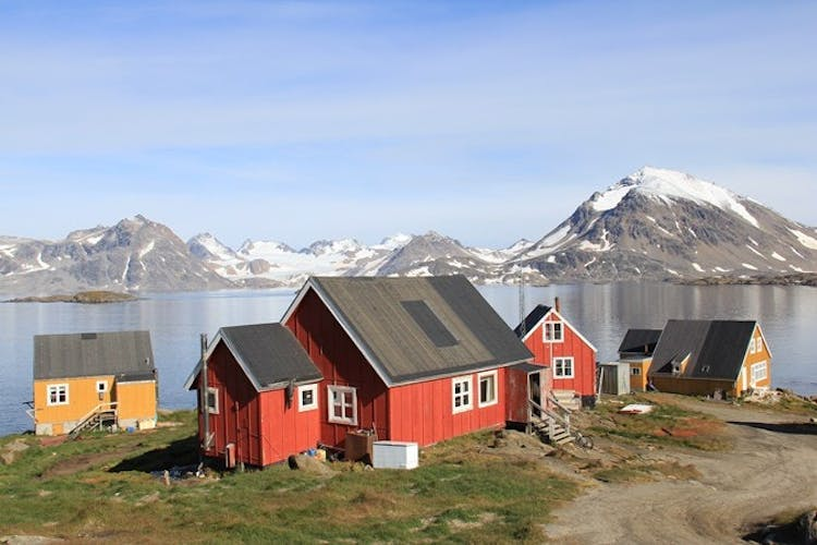 Traditional, colourful houses under the summer sun in Kulusuk, Greenland.