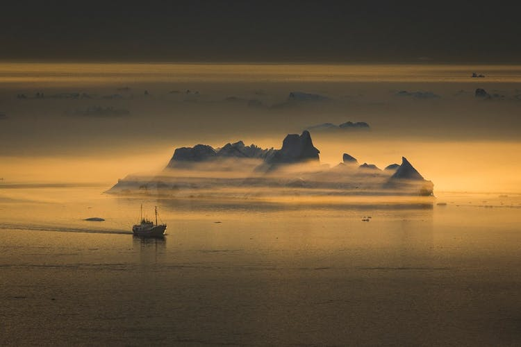 The icebergs in Greenland's summer seas are like large islands.