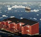 Klasyczny dom, który spotkasz jeżeli wybierzesz się na wakacje na Grenlandii.