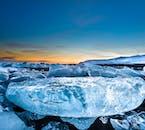 Clear ice lying on the black sand beach of the Diamond coast, near to Jökulsárlón glacier lagoon.