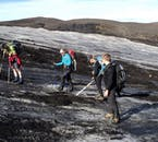 Walking poles and crampons make navigating the glaciers of Iceland easy.