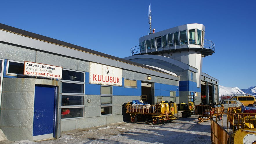 Kulusuk's airport has four walls and a roof; it is incomprehensible why anyone would leave it. Wikimedia, Creative Commons, photo by Algkalv