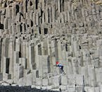 The distinctive basalt stacks in the cliff faces of Reynisfjara black sand beach.