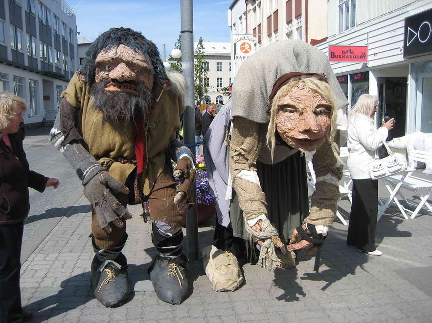 These Icelanders, pictured with two tourists, are from Akureyri; you can tell because they do not burn your eyes to look upon.
