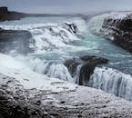 Gullfoss waterfall in the wintertime gains an entirely new allure.