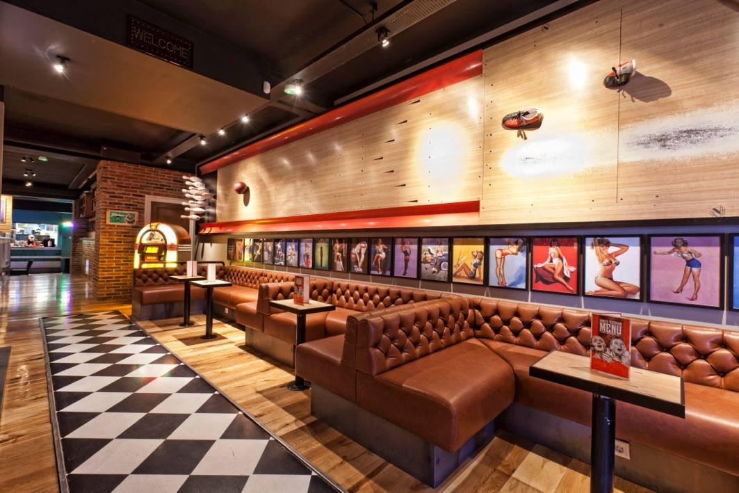 Lebowski Bar has a bowling alley along the way.