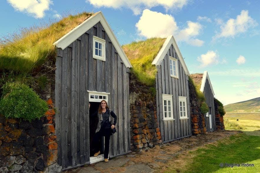 Regína posing by Þverá turf house in Iceland