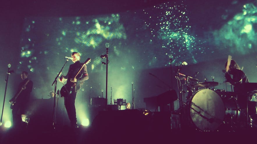 Sigur Rós at the Heineken Music Hall, Amsterdam, 2013. From left to right: Georg Hólm, Jónsi and Orri Páll Dýrason. Wikimedia. Creative Commons. Credit: Alive87.