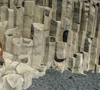Distinctive basalt columns on the black sand beach, Reynisfjara.