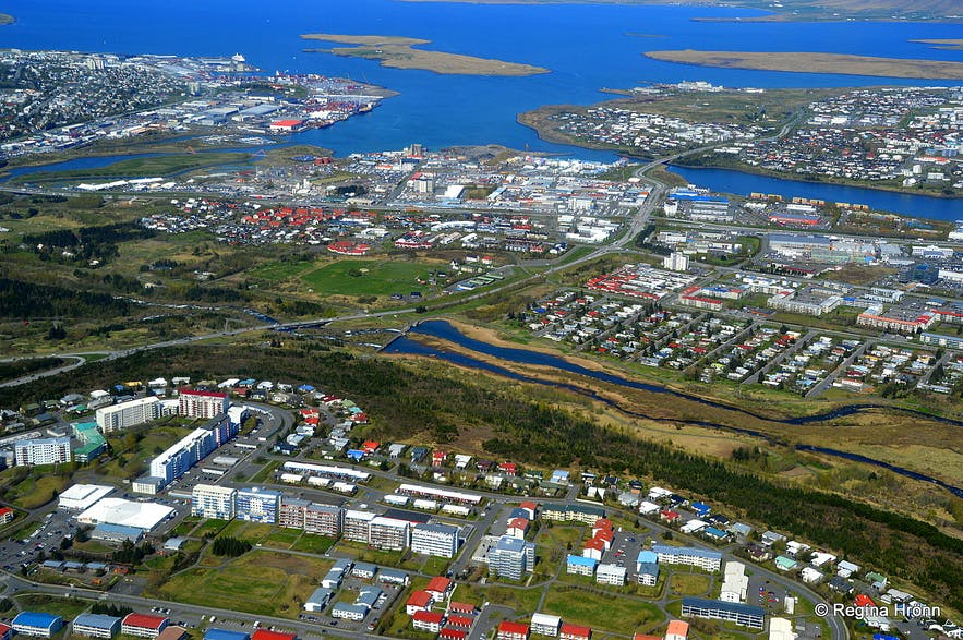The view of suburbian Reykjavík from a helicopter