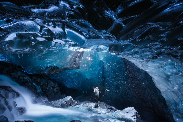 Ice caves are formed when underground rivers cut through the ice caps that make up Iceland's glaciers.