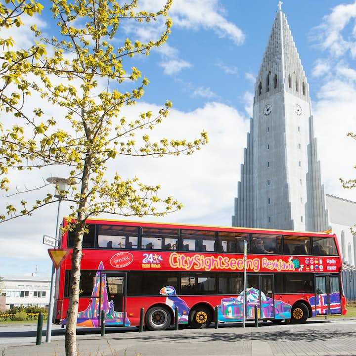 The City Sightseeing Bus as it passes by the Lutheran Church, and cultural landmark, Hallgrímskirkja.